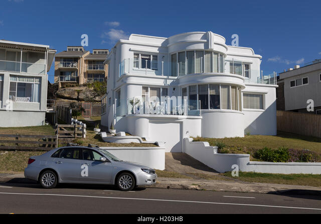 Curved White Coloured House Overlooking The Beach At South Curl Curl On The Northern  Beaches Of