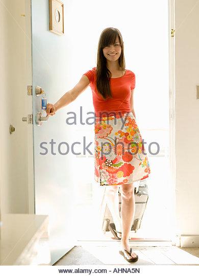 Woman opening hotel room door - Stock Image
