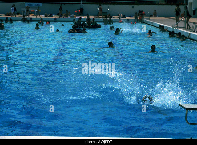 Public Swimming Pools With Diving Boards indoor swimming pool with diving board stock photos & indoor