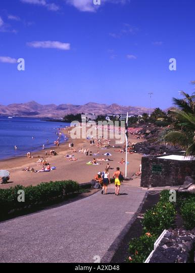 Lanzarote girl beach stock photos lanzarote girl beach - Lanzarote walks from puerto del carmen ...