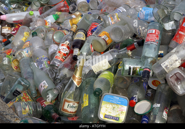 Recovered glass - white bottles in recycling plant - Weißglas / Altglas in Sammelstelle - Stock Image