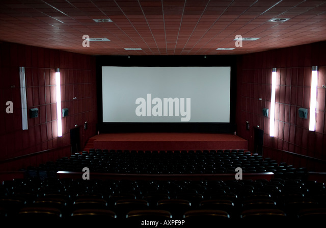 empty cinema hall with a large projector screen stock image
