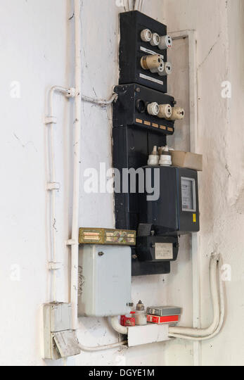 old fuse box with an electricity meter and electrical wiring on a dgye1m old fuse box stock photos & old fuse box stock images alamy building regulations fuse box location at readyjetset.co