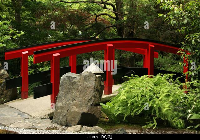 Japanese style garden stock photos japanese style garden for Japanese style bridge
