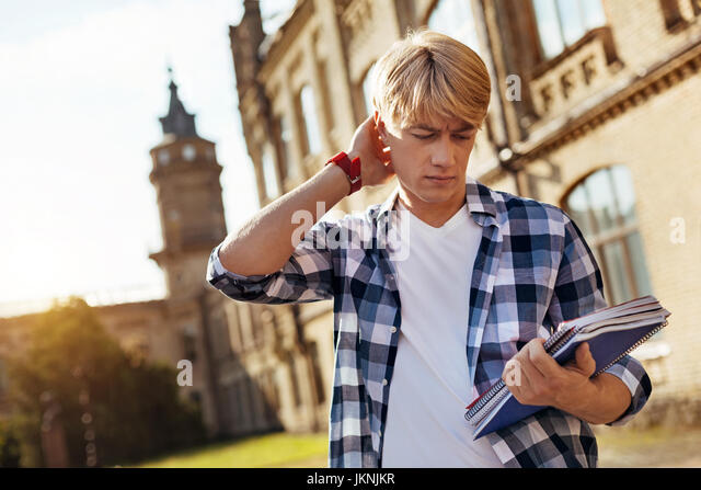 Troubled confused guy thinking about the assignment - Stock Image