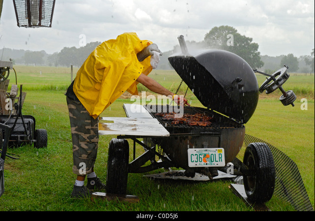 barbecue and rain stock photos barbecue and rain stock images alamy. Black Bedroom Furniture Sets. Home Design Ideas