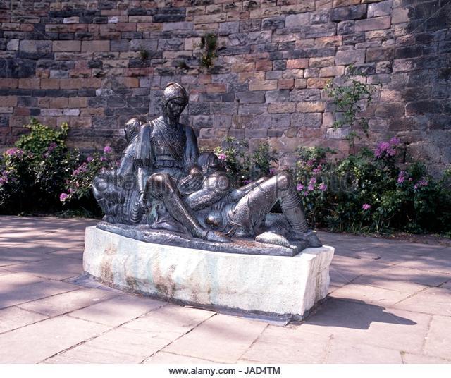 Robin Hood related bronze statue of Friar Tuck, Will Scarlet and Little John outside the castle, Nottingham, Nottinghamshire, - Stock Image