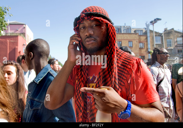 keffiyeh. young man wearing traditional keffiyeh talking on mobile phone - stock image r