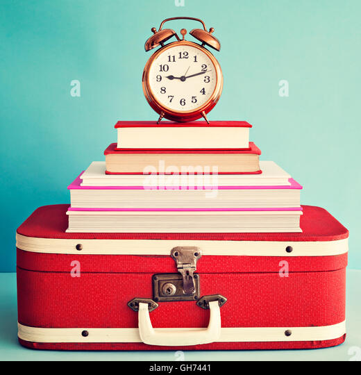 Vintage suitcase stock photos vintage suitcase stock images alamy vintage alarm clock over books and suitcase stock image gumiabroncs Choice Image