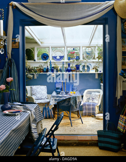 Blue Chairs At Table With PVC Cloth In Dining Room White Drape Above Double Doors