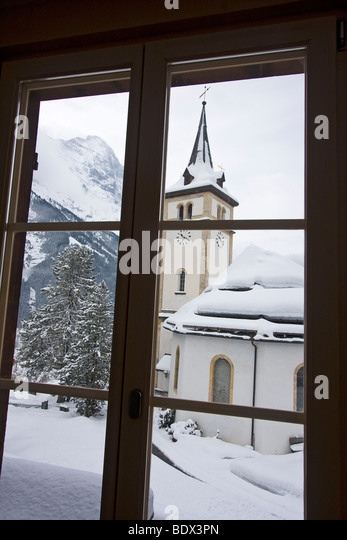 View Of Grindelwald Switzerland Through A Window Here We See Church