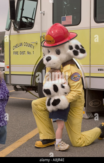 sparky the fire dog book. sparky the fire dog hugging a small girl at safety day event - stock image book