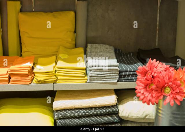 Gloves, Rags, Table Clothes And Other Kitchen Wear On Shelves   Stock Image