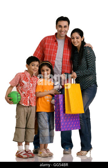 Indian Family Shopping Bags Stock Photos & Indian Family Shopping ...