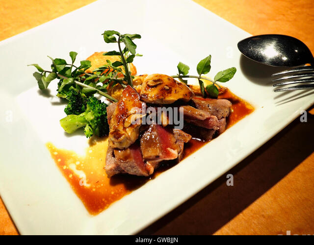 Pan Fried Beef With Foie Gras With Green Vegetables On The Side Stock Image