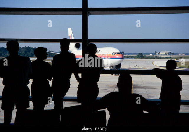 commercial airliner taxis past terminal passengers in terminal awaiting flights hartsfield international atlanta