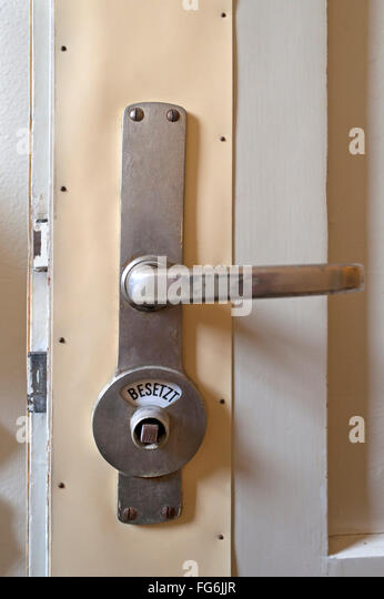 Toilet door lock stock photos toilet door lock stock for Door lock germany