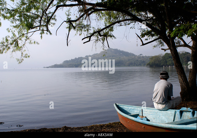 boat-operator-contemplating-misty-lake-c