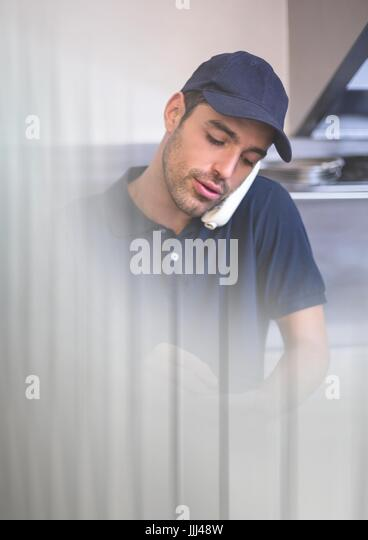 Delivery Courier on phone with transition effect and copy space - Stock Image