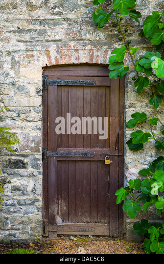 Beautiful Padlocked Wooden Gate In Old Garden Wall   Stock Image