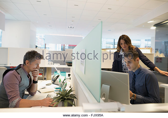 Business People Working At Cubicles In Office