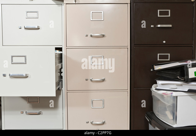 Funky File Cabinets With Binders Boxes.   Stock Image