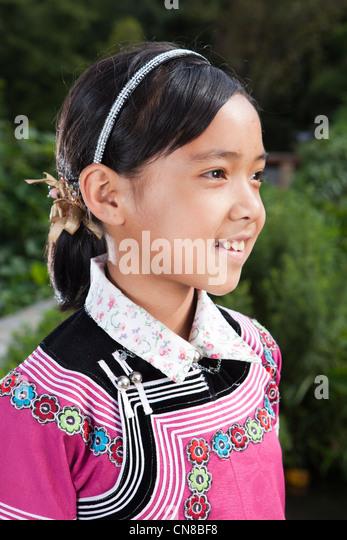 Hani minority girl on traditional cloth, Xinjiezhen, Yuan Yang, YunNan, China - - hani-minority-girl-on-traditional-cloth-xinjiezhen-yuan-yang-yunnan-cn8bf8