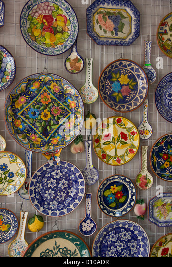 decorative plates and spoons on a wall stock image - Decorative Wall Plates