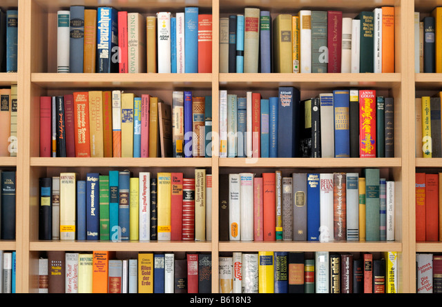 Bookshelf filled with books - Stock Image
