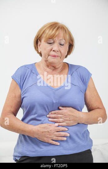 abdominal pain elderly stock photos   abdominal pain doctor at home il doctor at home orlando