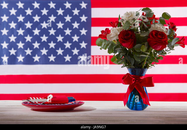 Red white blue flowers flag stock photos red white blue flowers table with beautiful blue red and white bouquet and table setting in front of american flag mightylinksfo