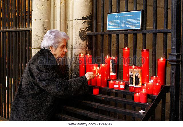 Elderly woman lighting a candle in front of a chapel in the cloisters of Barcelona Cathedral & Woman Lighting A Candle Stock Photos u0026 Woman Lighting A Candle ... azcodes.com
