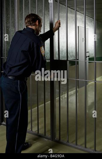 A prison guard locking a prison door - Stock Image & Prison Doors Stock Photos u0026 Prison Doors Stock Images - Alamy pezcame.com