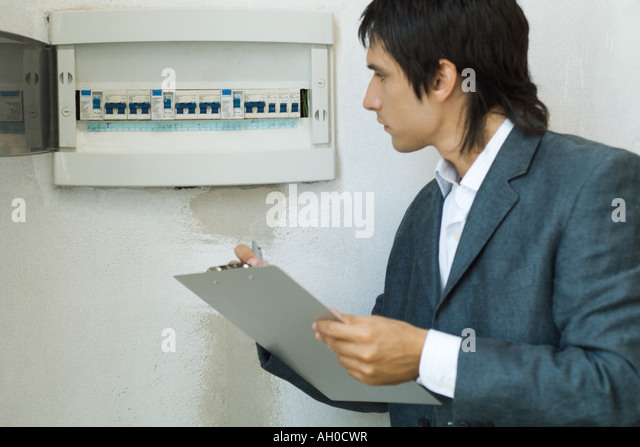 fuse boxes stock photos fuse boxes stock images alamy man inspecting fuse box stock image