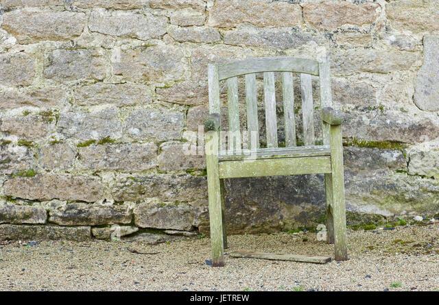 Rotting Chair Before A Natural Stone Wall, Verrottender Stuhl Vor Einer  Natursteinmauer   Stock Image