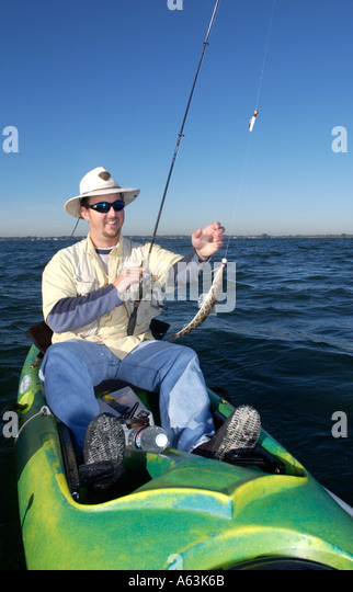 Man fishing from kayak caught lizard fish intracoastal for Port st lucie fishing