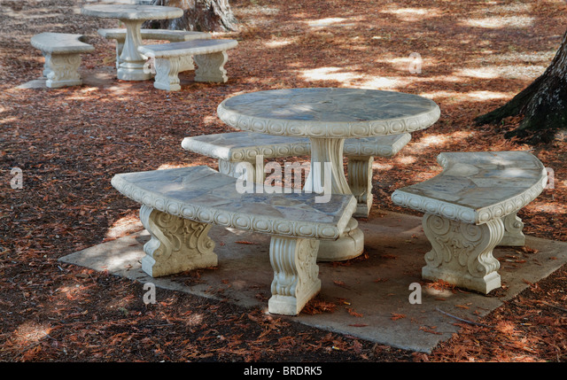 Concrete And Stone Round Picnic Tables In A Wooded Grove   Stock Image