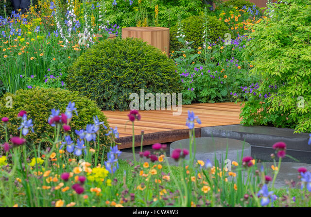 Homebase garden urban retreat designed stock photos for Garden trees homebase