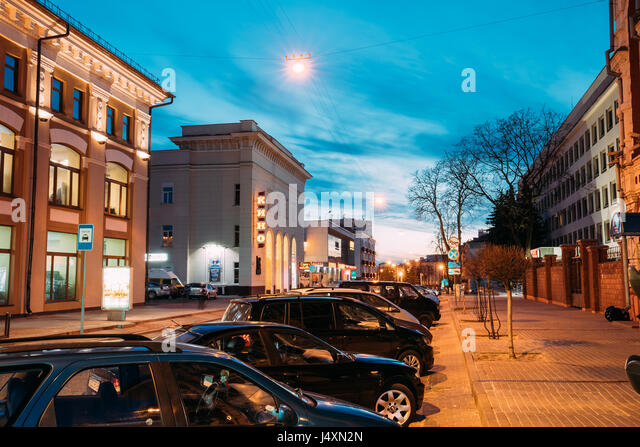 Gomel, Belarus - March 23, 2017: Cars Parking At Kommunarov Street Near Old Department Store At Evening In Night - Stock Image