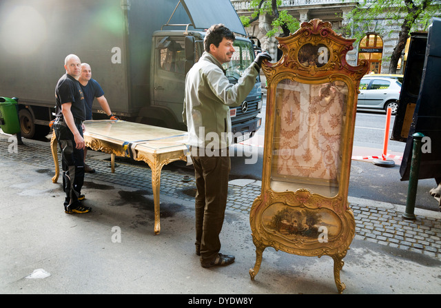 Furniture removal men / removals / house move / movers in the street with  antique and - Movers Of Antique Furniture Stock Photos & Movers Of Antique