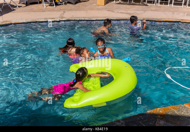 Latino children stock photos latino children stock images alamy for What is a freshwater swimming pool