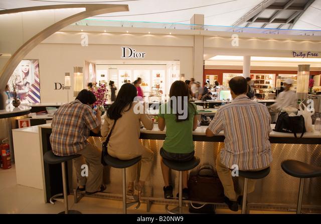 passengers waiting airport shopping stock photos passengers waiting airport shopping stock
