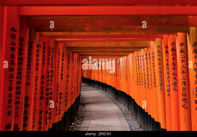 Red Tori Gate at Fushimi Inari Shrine in Kyoto, Japan - Stock Image