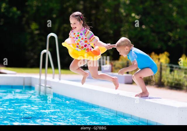 Boy Jumping Into A Pool Stock Photos Boy Jumping Into A