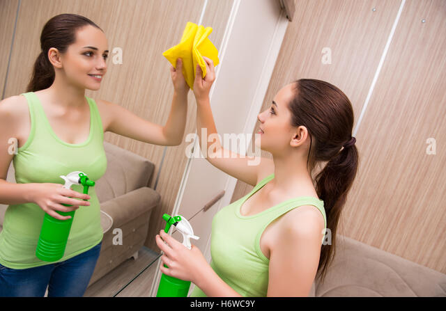 Hardworking young lady cleans the kitchen before pounding 3