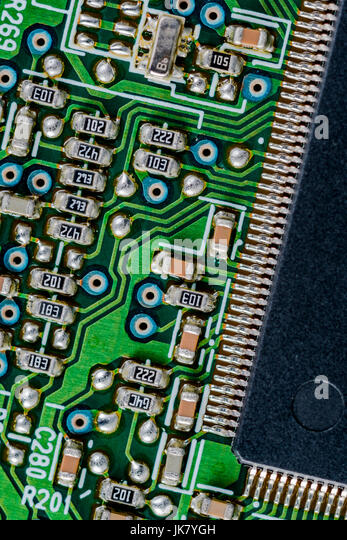 Surface mount technology (SMT) components on a green printed circuit board. Interconnected concept. Wiring inside - Stock Image