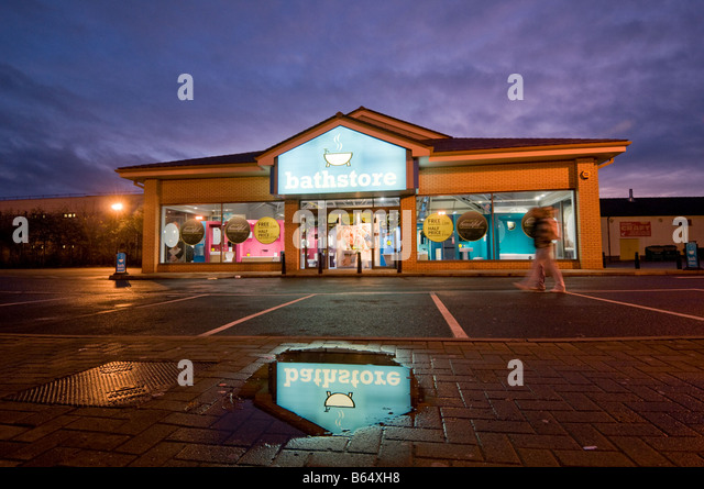 The Bathstore bathroom fittings store in a retail park at night  logo  reflected in a. Bathstore Stock Photos   Bathstore Stock Images   Alamy