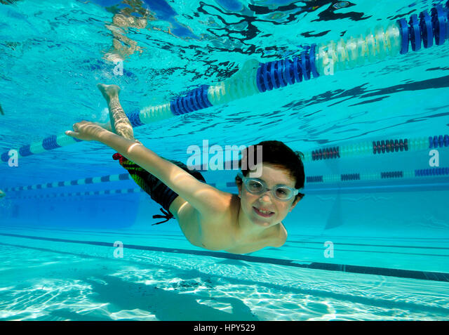 Kids Swimming Underwater children swim in pool underwater stock photos & children swim in