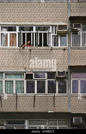 Woman Looking Happily Out Of An Apartment Complex Window In Wan Chai, Hong  Kong, Part 86