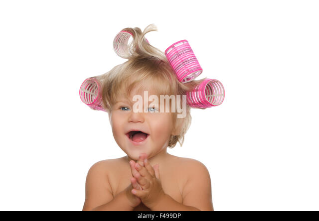 Little Laughing Girl With Hair Curlers Stock Image